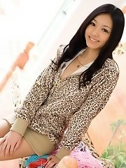 Aino is an Asian model who enjoys posing